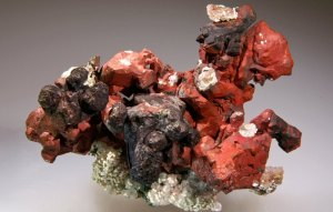 A copper specimen from the Phoenix Mine in Keweenaw County. The red color comes from a thin coating of the mineral cuprite. MTU photo by  Debra Wilson