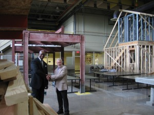 Magee and Schult in the Granger Center's framing laboratory, where students learn how to build structures with both wood and metal frames.
