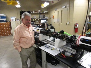 Dr. Guy Meadows, director of Michigan Tech's Great Lakes Research Center, shows me a submersible sonar mapping device that's in the shop at GLRC for repairs.