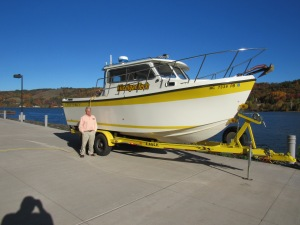 Dr. Guy Meadows with one of Michigan Tech's smaller research vessels.