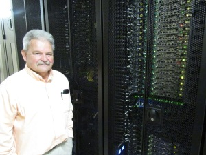 Dr. Guy Meadows with Michigan Tech's new supercomputer -- essentially nearly 1,500 Dell computers hooked up in parallel.