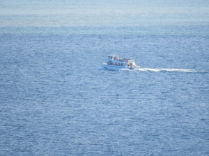 A Pictured Rocks tour boat steams out of Munising.