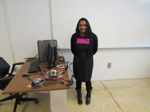 Rajani Muraleedharan, assistant professor of Electrical and Computer Engineering at Saginaw Valley State University, with one of the drones involved in her experiment that may someday be used for autonomous exploration of Saturn's moon Titan.