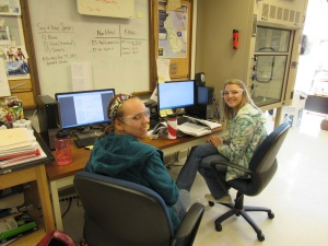 Working in associate professor Tami L. Sivy's lab are (left) Marissa Dobulis of Freeland and Alexandra Steele of Caro.