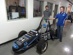 Garrett Pelowski of Farmington Hills (left) and Greg Quante of Rochester show off the Grand Valley State University Formula SAE race car.