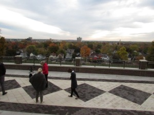 WMU alumni and development staff check out their new view of Kalamazoo from the top of Prospect Hill, looking east.