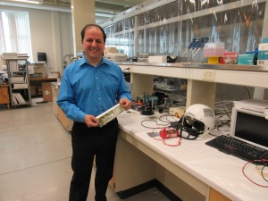 Massood Zandi Atashbar with samples of printed electronics in his laboratory at WMU's College of Engineering and Applied Sciences.
