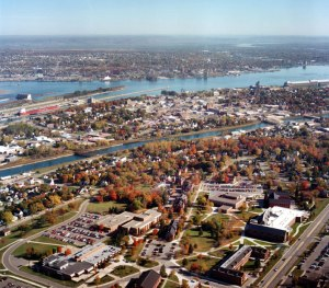 An aerial view of Lake Superior State's campus in relation to Sault Ste. Marie and the Soo Locks. Across the river at the top of the picture is Ontario, Canada.